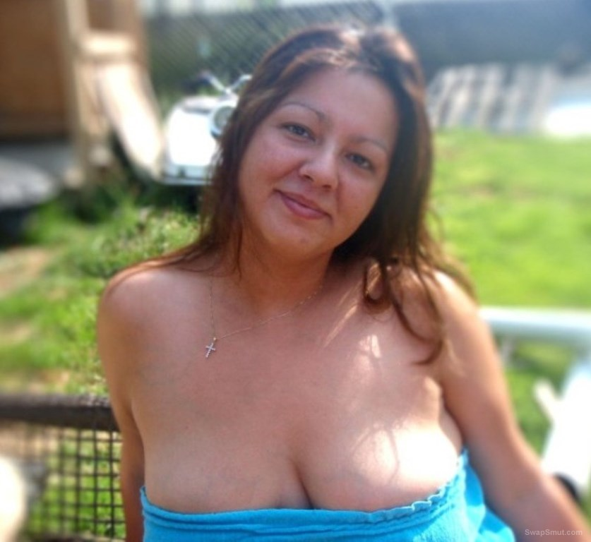 A stunning BI wife posing in and around the hosue