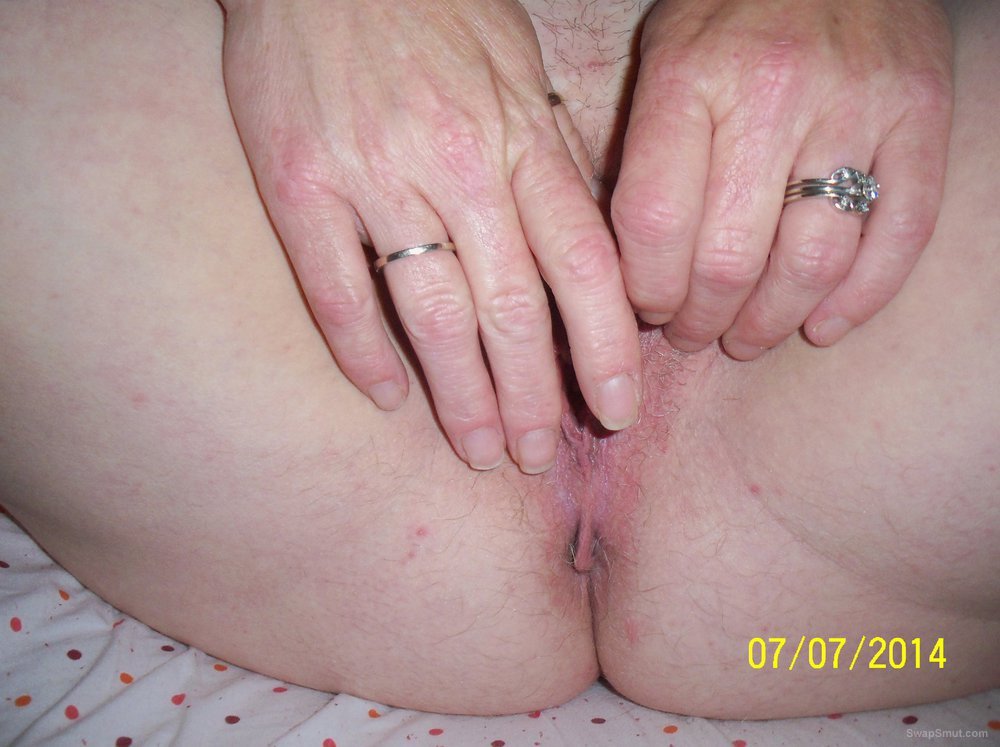 Wife spreading her cunt open wide for all to see