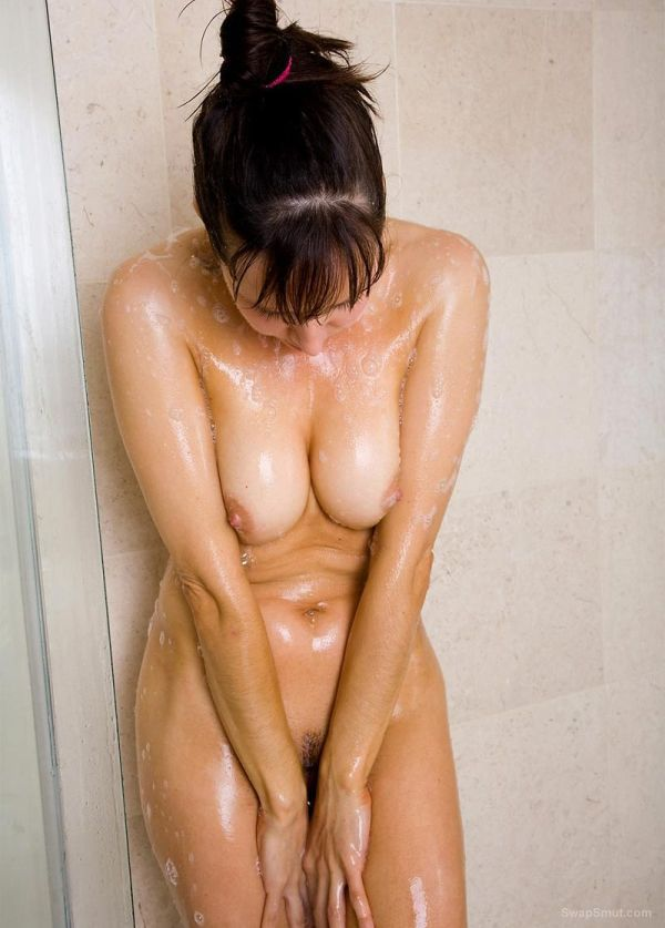Sexy lady in shower with pert tits and pussy showing pink
