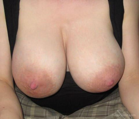Blonde big titted bitch showing her assets off before a fuck