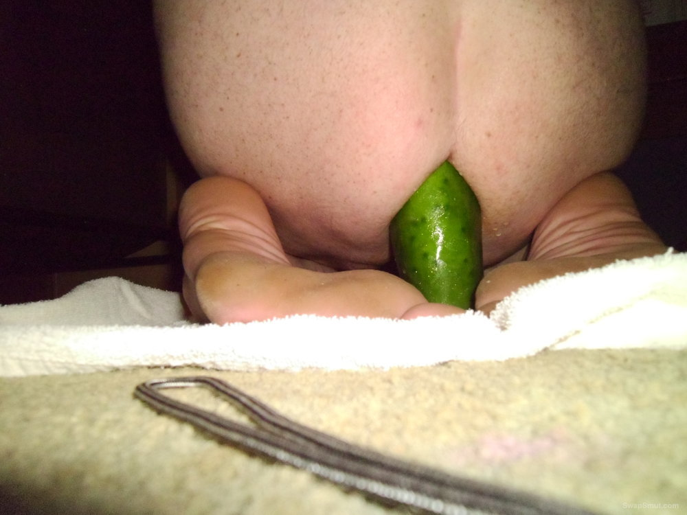 Big cucumber in ass
