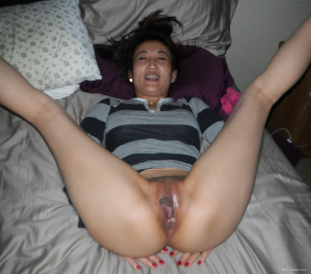 Asian milf looks at crotch