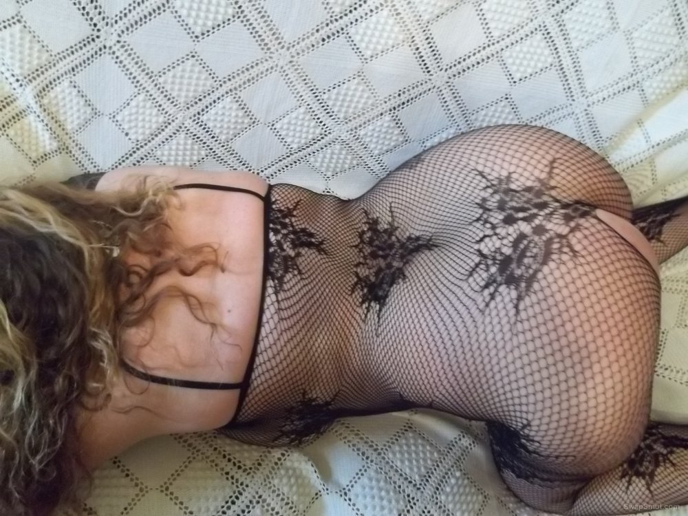 Sexy wife showing pussy wearing a crotchless fishnet body stocking