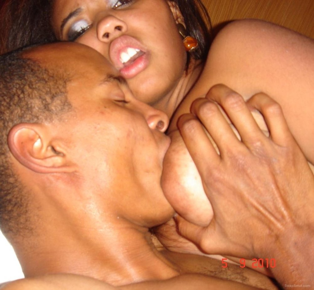 Black man giving woman oral sex