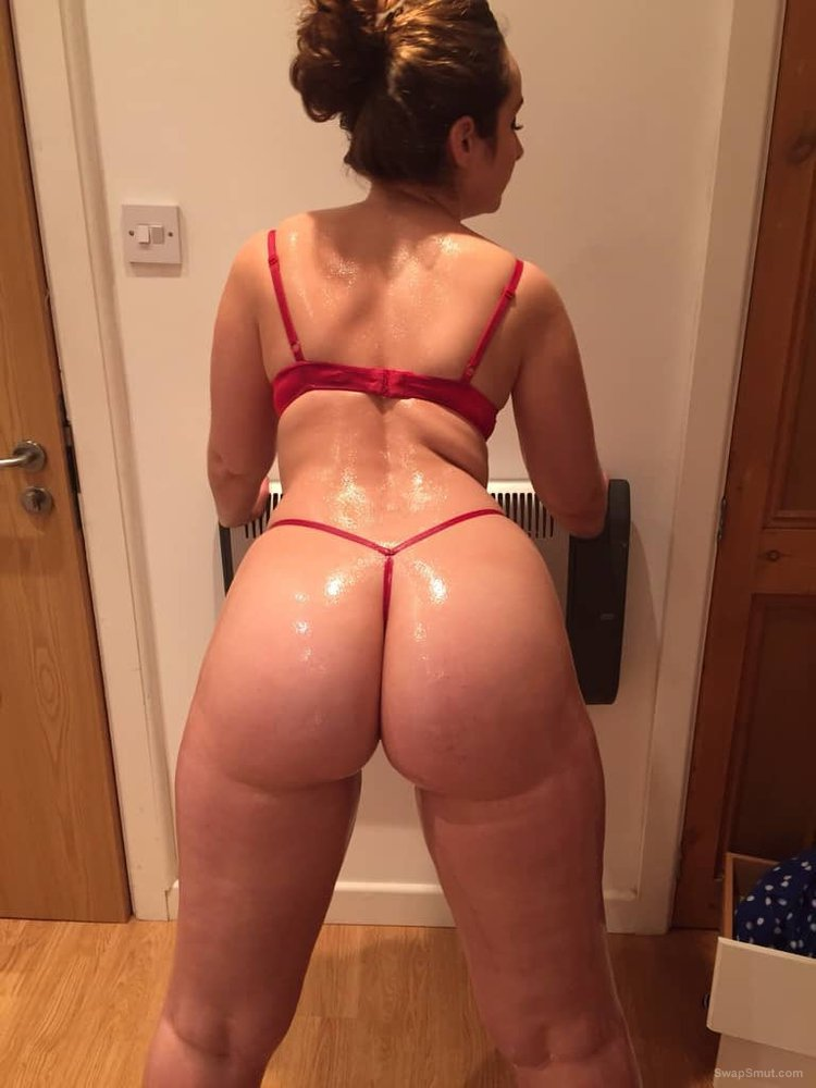 Beautiful oiled ass wearing only a G string