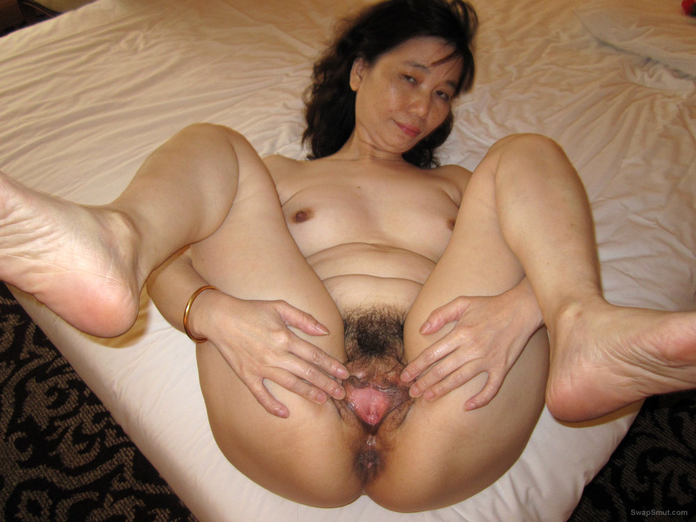Ann Spreads Her Legs to Show Off Her Juicy Hairy Asian Gash