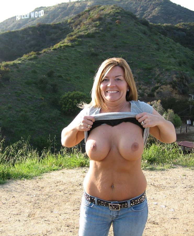 a USA MILF SWINGER exposing her body in public and oral sex