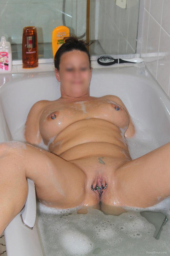 Brunette in lingerie with pierced pussy lips spready labia