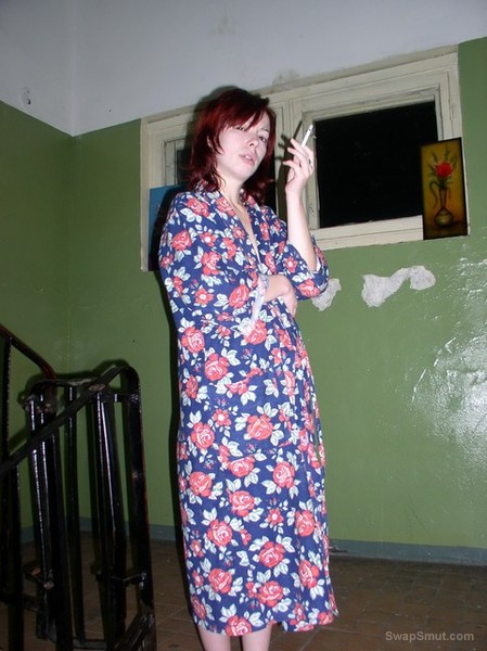 Redheaded with a cigarette, a sexually attractive woman