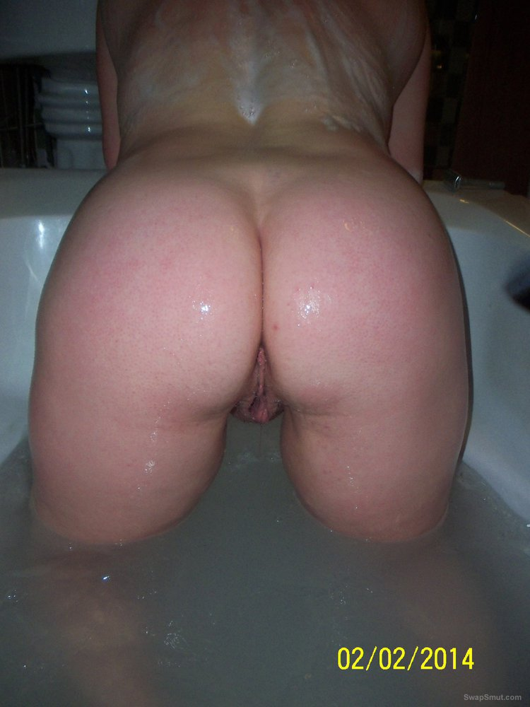 Big titted wife showing off tits and ass in the bathroom