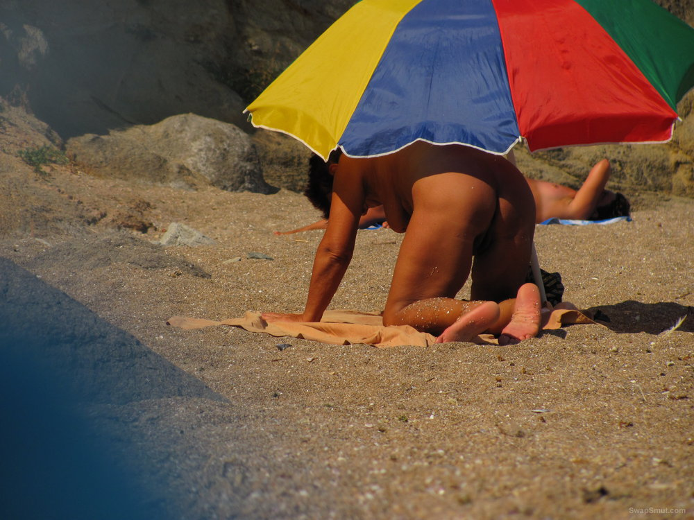 Amazing granny tanning her hairy cunt at the public beach