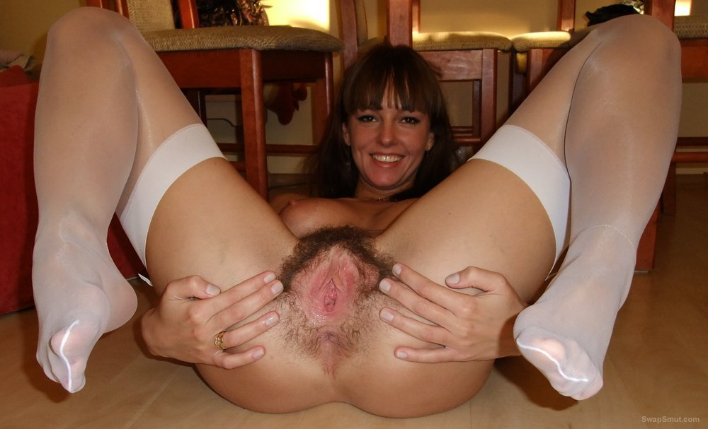Hairy cunt slut in stockings spreading her cunt wide