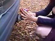 Amateur showing her pierced labia in public and riding a car tow bar