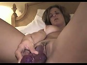 Nude woman masturbating with her rampant rabbit vibrator sex toy