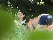 Young lovers caught outdoors in the park having sex in public