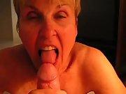 Mature blonde granny slurping on my cock