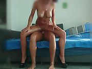 Busty amateur gliding up and down cock