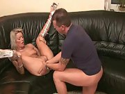 Dirty blonde gets fucked and fisted on the sofa