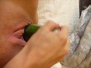 cucumber stuffed inside a greedy pussy